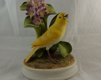 """Vintage Canary by Andrea Sadek, Features a Canary Setting in Purple Hyacinth Flowers and Green Stalks,  7 1/4"""" Height"""