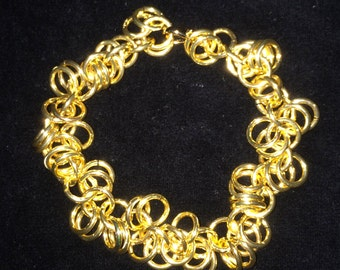 A Shaggy Loops Chainmaille Bracelet. Anodized Gold Tone Aluminum.