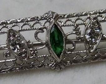14 karat white gold filigree bar pin with diamonds and garnets