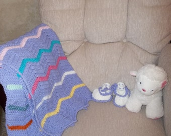 Hand crocheted baby blanket.  Includes a free pair of matching baby booties.