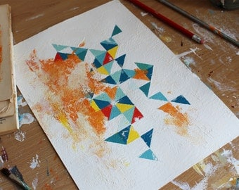 Vibrant grungy triangle painting on A4 paper