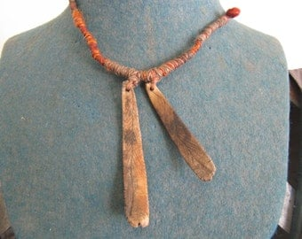 earthy orange pit fired ceramic pendant necklace