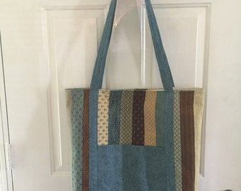 Large tote bag. In colors of blues and browns.