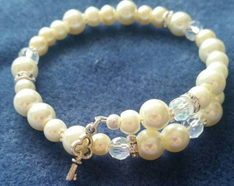 Ivory pearl and crystal memory wire bangle.