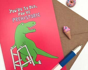 Dinosaur 'you're so old you're prehistoric' greeting card (A6). Kitsch birthday card for old dinosaurs and dinosaur lovers.