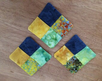 3 handmade fabric coasters. Batik-style 100% cotton front and back.