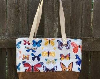 Tote bag with leather handles and canvas bottom
