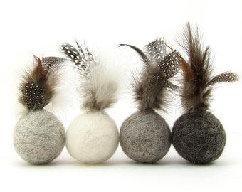 Feather ball cat toy made from wool in neutral colours