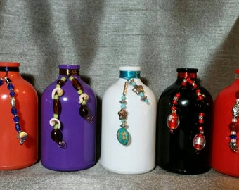 Glass Bottle, wire wrapped with beads or stones.