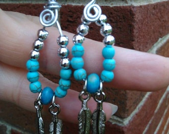 Handmade Turquoise and silver dangle earrings with silver feathers