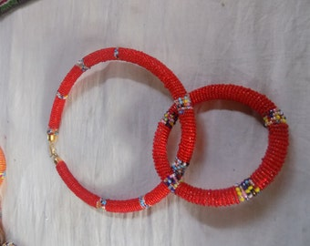 A bead necklace and bangle sold as a pair