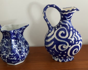 an assortment of pottery ceramic glass pitchers
