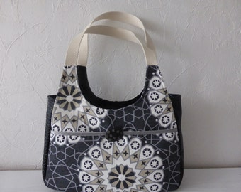 Fabrics printed black and white lace effect handbag