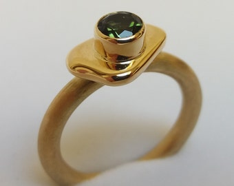 Beautiful gold ring with green tourmaline