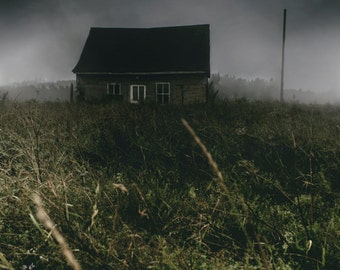 The small house in the dark meadow