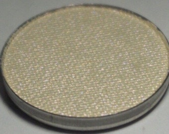 Lyra Pressed Eyeshadows - Creamy Gold Base with a Stong Corally Red Shift