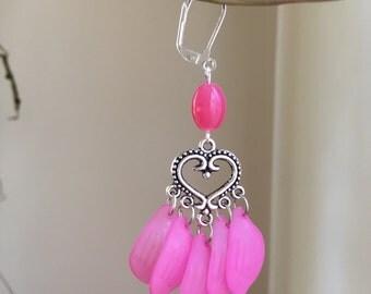 Pink lucite petal light weight earrings.
