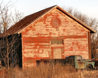 Rustic red barn with truck