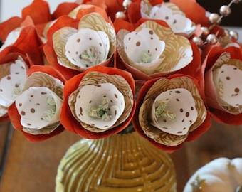 Paper flowers in ceramic vase