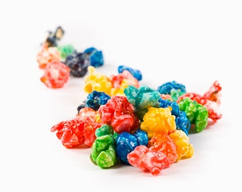 This brightly colored gourmet popcorn has a taste that will leave you reaching for more!- flavored popcorn - color popcorn- sweet popcorn