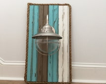 Coastal Light Fixture accented with rope. Painted and distressed wood