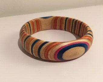 Bracelet from recycled skateboard.