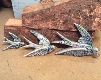 Set of three handmade ceramic flying birds