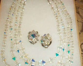 Vintage 4 Strand Aurora Borealis Crystal Necklace with Matching Clip On Earrings From 1920s