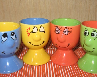 Set of 4 supports for the eggs wiht smiling faces, 4 pieces, China
