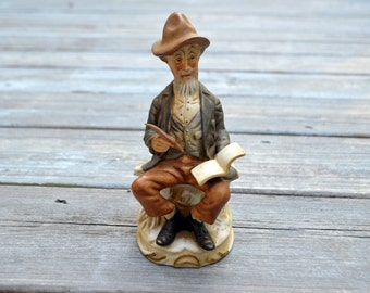 Vintage Bisque Old Man Seated with Writing Quill and Notebook Figurine
