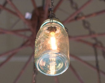 Outdoor/Indoor Chandelier Made out of Wagon Wheels & Mason Jars