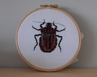 Insect in cross stitch