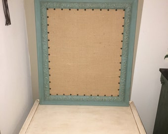 Burlap bulletin board with nailhead trim and antique refinished wooden frame