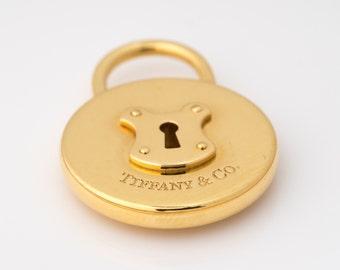 Tiffany & Co. 18k Gold *Circular Lock Pendant*, VJ #11