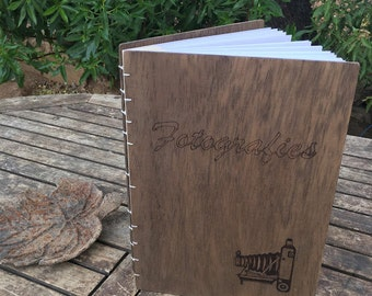 Personalized photo album with wooden tops,