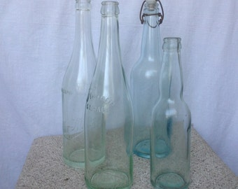 Four antique colored glass bottles