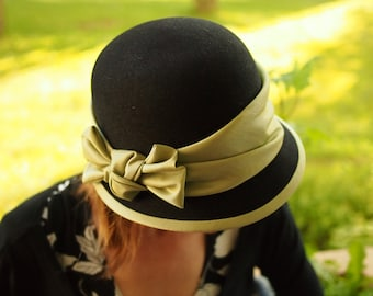 Black felt hat with green satin