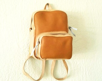 Mini backpack in New and Recycled Leather Mix