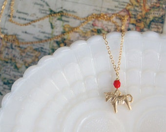 Gold plated dala horse necklace with red bead detail- scandinavian vintage style