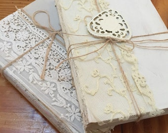 Two white washed shabby chic vintage wedding book riser decor