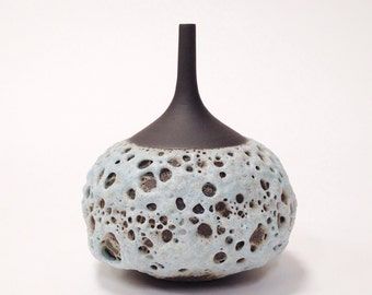 MADE TO ORDER-  1 small rotund ceramic stoneware vase in ice blue crater glaze and raw black clay by sara paloma.   Mid century modern