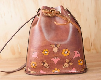 Leather Drawstring Backpack Tote - Handmade Bucket Bag in the Meadow Pattern with Bees and Honeycomb - Pink, orange and antique mahogany