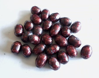 Faceted Oval Cranberry Pearls - set of 12