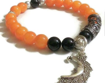 Black onyx dyed orange mountain jade Moon charm bracelet