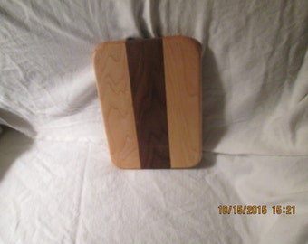 Maple and walnut cheese cutting board