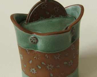covered jar green verdigris glaze with starburst pattern on red clay
