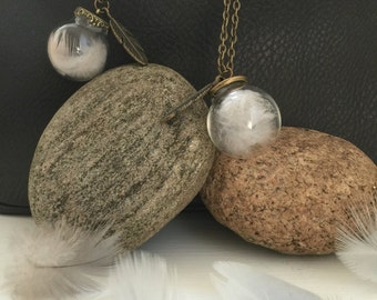 Bird feather in glass globe sphere bauble necklace