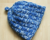 Hand-knit child's blue and white hat