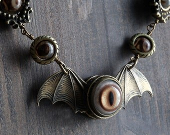 Steampunk goth Jewelry -  NECKLACE - antique brass winged eyeball with Tibetan agate stones.