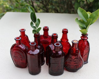 Collection of small red bottles, vases, liquor, wheaton glass, jenny lind, t. jefferson, whiskey bottle, miniature vases, wedding decor